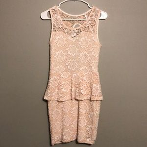 Stretchy dress with lace overlay.